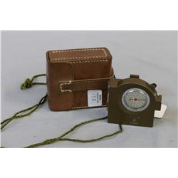 Vintage Japanese field compass with leather carrying pouch