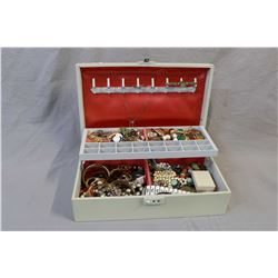 Jewellery case filled with vintage and collectible costume jewellery including signed Trifari, Forte
