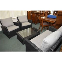 Four piece, near new simulated wicker patio suite including loveseat, two armchairs and coffee table