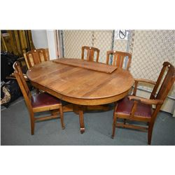 Antique Canadiana quarter cut oak center pedestal dining table with five triple slat back chairs inc