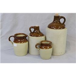 Four pieces of glazed stoneware including a one gallon and a half gallon jug and two English made Pe