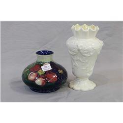"Small Moorcroft anemone vase and a 7"" green mark Belleek vase"