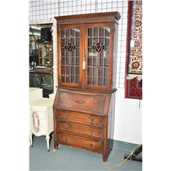 Antique oak fall front bureau with three drawers, desk with fitted interior topped with glazed displ