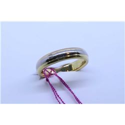 Lady's Cartier 18kt yellow, rose and white gold wedding band. Retail replacement value $2,000.00
