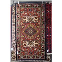 Wool scatter rug with center medallion and overall geometric pattern, rust background with highlight