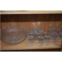 Shelf lot of collectible cornflower crystal including drinking glasses, small plates, set of eight w