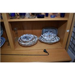 Shelf lot of collectibles including glass candlesticks, antique semi porcelain platters, selection o