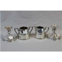 Silver-plate cream and sugar and an International sterling candleholders with weighted bases