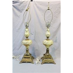 Pair of vintage cast and hand painted glass table lamps and a small needlework upholstered foot stoo