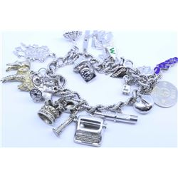Sterling silver chaised hinged bracelet and a silver charm bracelet