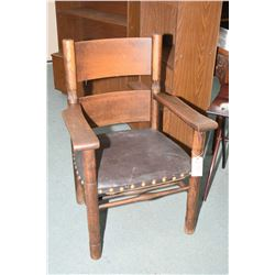 Large arts and crafts oak arm chair with leather upholstered seat, nail head decoration and original