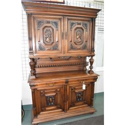 Antique three section court cupboard with four raised panel doors, lower section with carved cartouc