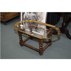 Coffee table with heavy twist wooden base and removable brass and glass top