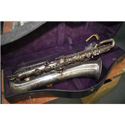 Vintage nickel plated True tone low pitch Buescher saxophone made in Elkhart Ind., serial No. 24141.