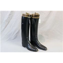 Vintage pair of leather riding boots in boot stretchers