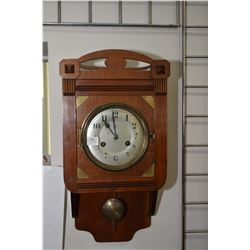 Small arts and crafts walnut chiming wall clock, working at time of cataloguing
