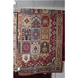 Wool area carpet with geometric mosaic tile pattern with red background with highlights of blue, tau