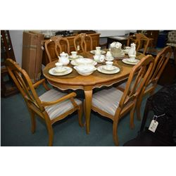 French country dining suite with dining table with two skirted leaves and six upholstered seat dinin