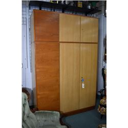 Large six door Danish style cabinet fitted with multiple adjustable shelves