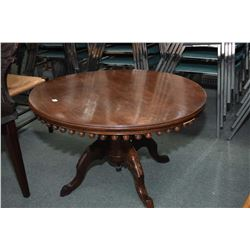 Highly decorative, center pedestal vintage coffee table