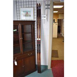 Pair of vintage Sigmund Ruud cross country skis with bindings 215cm in length, made in Norway