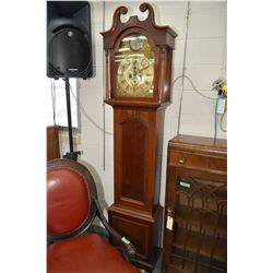 Antique long case weight driven chiming clock in mahogany cabinet with swan neck frieze, brass dial,