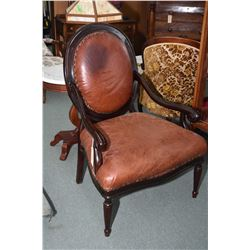 Pair of mantastic open arm leather upholstered parlour chairs with nail head decoration, one brown a
