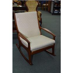 Teak framed upholstered open arm rocking chair
