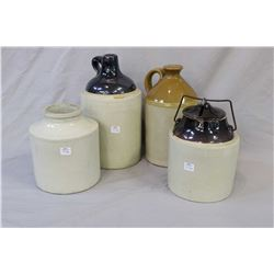 Four pieces of stoneware including a lidded pickle crock, two jugs and a Red wine stoneware crock