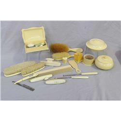 Large selection of vintage French ivory including dresser pieces, clothes brushes, lidded dresser ja