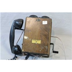 Walnut cased North Electric hand crank wall phone