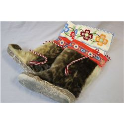 Pair of seal skin mukluks with embroidered wool lining