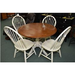 Center pedestal dining table and four spindle back chairs made by Ethan Allen