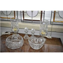 Selection of crystal including two bedside table lamps, two center bowls and a pair of candlesticks