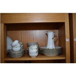 Shelf lot of Limoges china including plates, cups, saucers, platters, tea pot, cocoa pot, lidded ser