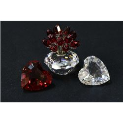 """Three Swarovski crystal figures including vase of roses 2 3/4"""" in height, plus a red heart and a cry"""