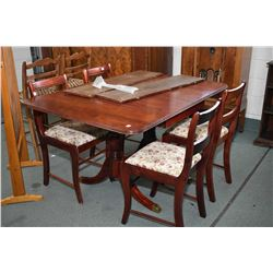 Mid 20th century Regency style drop leaf dining table with two insert leaves and four dining chairs