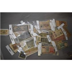 Collection of foreign coins and approximately 57 foreign bank notes, approximately 24 vintage cheque