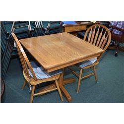 Square oak center pedestal pub table and a pair of oak arrow back chairs