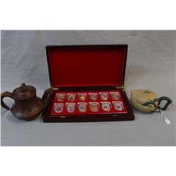 Twelve pieces cased Chinese lunar calendar medallion set in presentation/display cabinet and two Ori
