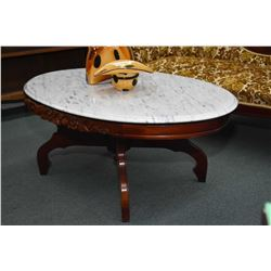 Two marble parlour tables including a coffee table with floral skirt and a lyre base occasional tabl