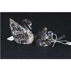 """Two Swarovski crystal figures including Centenary Swan 2"""" in height and a four leaf clover, both wit"""