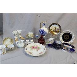 Collectible porcelain and glass including cobalt tea cups and saucers with hand applied decoration,