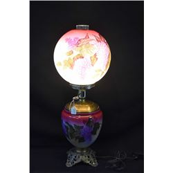 Antique converted oil banquet style lamp converted to electric with floral motif font and shade