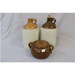 Four pieces of stoneware including lidded bean pot, two one gallon jugs and a one gallon crock