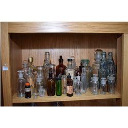 Shelf lot of collectibles including porcelain bed pan, large selection of bottles including medical,