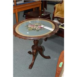 Small antique center pedestal tilt top occasional table with floral motif needlepoint and glass top