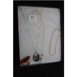 Selection of sterling silver jewellery including chaised locket, silver chain with clear stone penda