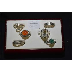 Six sterling silver rings including bands and gemstone set rings