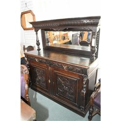 Antique oak sideboard with lion's head motif columns and drawer pull, North wind style raised panel